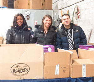 Volunteers Ashlee Davis, Jennifer Smith and Joey Canoro (left to right) prepare food packages for delivery. Photo courtesy Metropolitan Council on Jewish Poverty